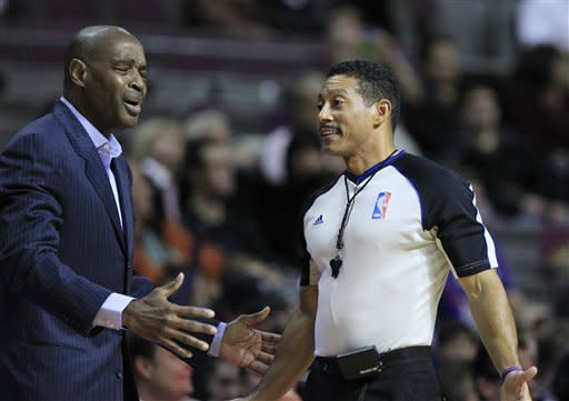 Atlanta Hawks head coach Larry Drew, left, reacts after a call by referee Bill Kennedy (55) during the second quarter of an NBA preseason basketball game at the Palace of Auburn Hills, Mich., Friday, Oct. 26, 2012. (AP Photo/Carlos Osorio)