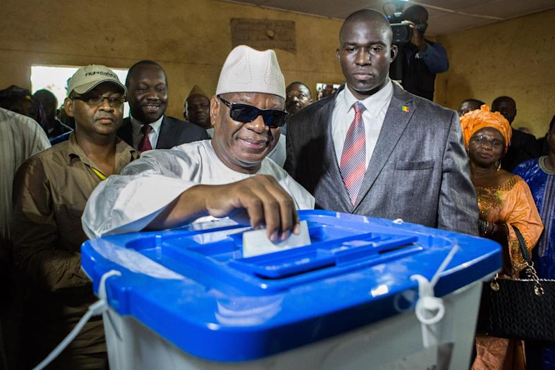FILE - In this Sunday, Aug. 11, 2013 file photo, presidential frontrunner Ibrahim Boubacar Keita casts his vote at a polling station in Bamako, Mali. The former prime minister has won Mali's presidency after his opponent conceded defeat before official results were announced. Soumaila Cisse went late Monday, Aug. 12 to Keita's home to congratulate him on his victory, according to spokesmen for both candidates. (AP Photo/Thomas Martinez, File)