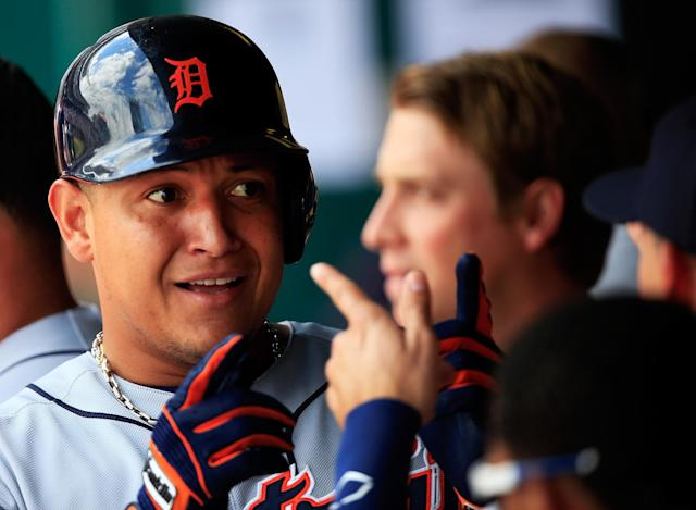 KANSAS CITY, MO - JULY 21: Miguel Cabrera #24 of the Detroit Tigers is congratulated by teammates in the dugout after hitting a home run during the 1st inning of the game against the Kansas City Royals at Kauffman Stadium on July 21, 2013 in Kansas City, Missouri. (Photo by Jamie Squire/Getty Images)