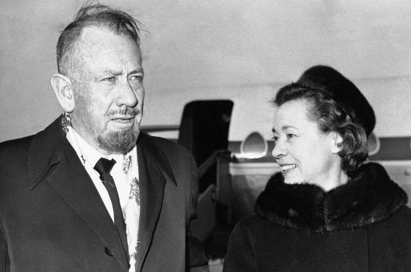 File - In this Dec. 13, 1962, file photo, shows author John Steinbeck, with his wife after their arrival at London Airport. A federal appeals court has thrown out $8 million in punitive damages against the daughter-in-law of Steinbeck in her long-running copyright spat with the late author's step-daughter. The 9th U.S. Circuit Court of Appeals on Monday, Sept. 9, 2019, upheld a $5 million verdict against Gail Steinbeck and told her it's time to end her legal saga. (AP Photo/File)