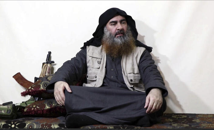 """FILE - This file image made from video posted on a militant website April 29, 2019, purports to show the leader of the Islamic State group, Abu Bakr al-Baghdadi, being interviewed by his group's Al-Furqan media outlet. The IS erupted from the chaos of Syria and Iraq's conflicts and swiftly did what no Islamic militant group had done before, conquering a giant stretch of territory and declaring itself a """"caliphate."""" U.S. officials said late Saturday, Oct. 26, 2019 that al-Baghdadi was the target of an American raid in Syria and may have died in an explosion. (Al-Furqan media via AP, File)"""