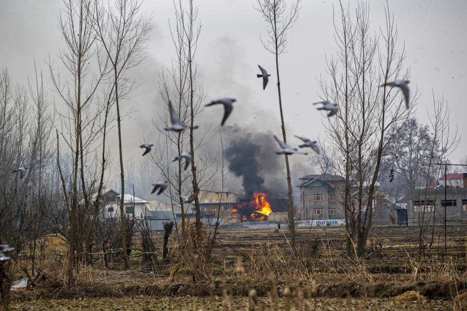 Flames and smoke billow from a residential building where militants are suspected to have taken refuge during a gun battle in Pulwama, south of Srinagar, Indian controlled Kashmir, Feb. 18, 2019. The image was part of a series of photographs by Associated Press photographers which won the 2020 Pulitzer Prize for Feature Photography. (AP Photo/Dar Yasin)