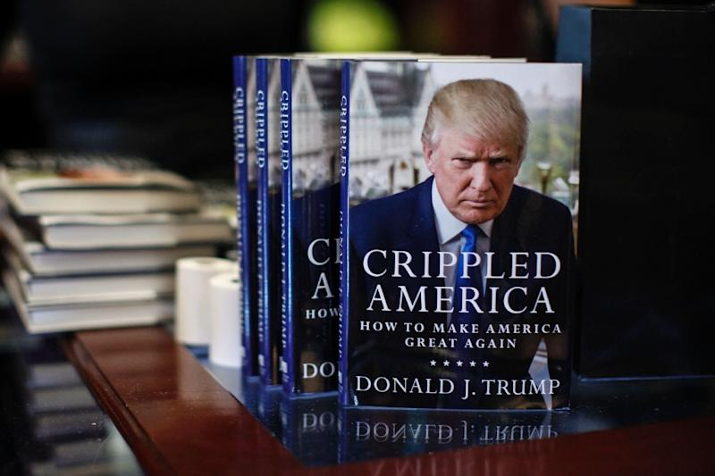 """Republican presidential hopeful Donald Trump's new book """"Crippled America: How to Make America Great Again"""" on display at Trump Tower on November 3, 2015 in New York (AFP Photo/Kena Betancur)"""