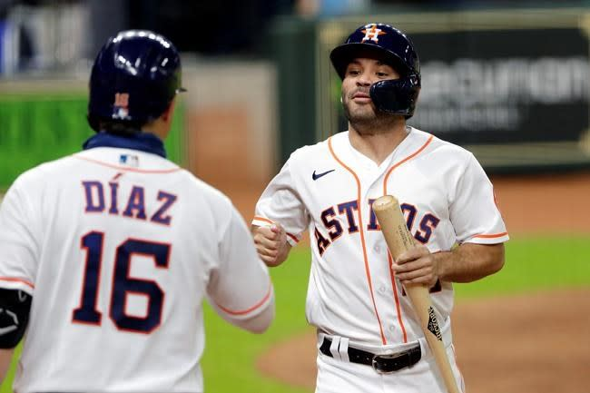 Altuve, Tucker lead Astros past D'backs to get back to .500