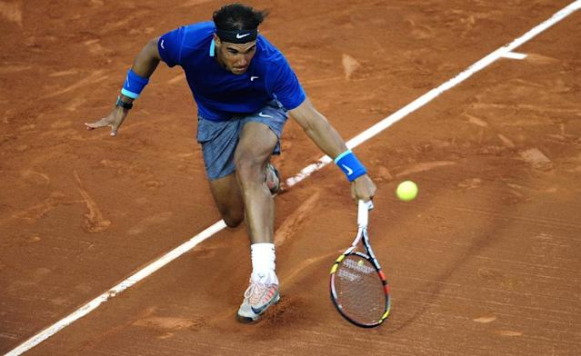 Rafael Nadal of Spain returns the ball to Ivan Dodig from Croatia, during the Barcelona open tennis in Barcelona, Spain, Thursday, April 24, 2014. (AP Photo/Manu Fernandez)