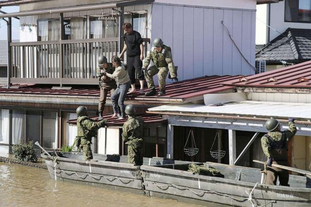 PHOTO: Local residents are rescued by Japapnese Defense-Force soldiers from a flooded area caused by Typhoon Hagibis in Kakuda, Miyagi prefecture, Japan, Oct. 13, 2019. (Kyodo via Reuters)