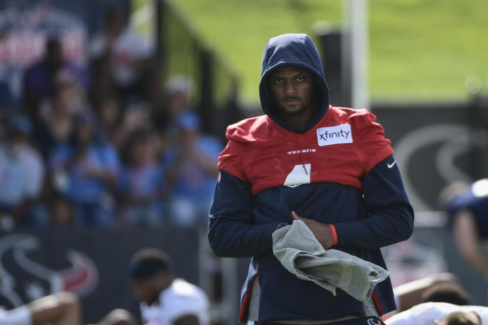 Texans quarterback Deshaun Watson (4) wipes his hands after stretching during NFL football practice Saturday, July 31, 2021, in Houston. (AP Photo/Justin Rex)
