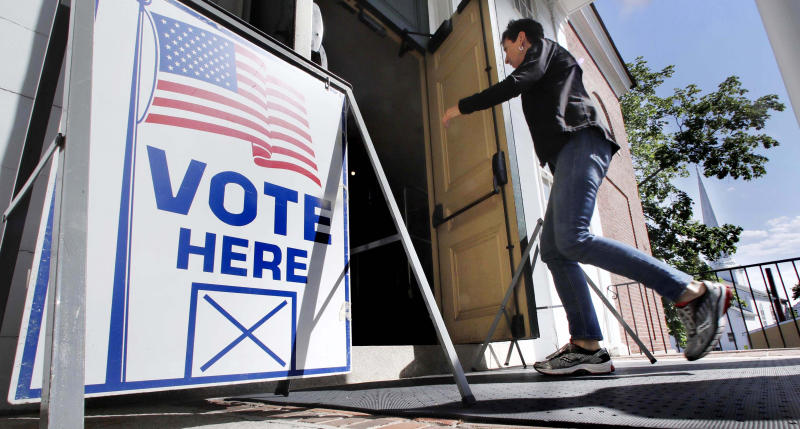 A resident arrives to cast her vote at a polling station at the Kennebunk Town Hall in Kennebunk, Maine, Tuesday, June 12, 2018. (AP Photo/Charles Krupa)