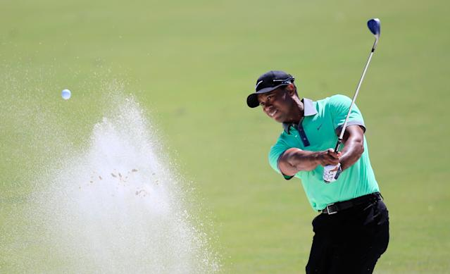 DORAL, FL - MARCH 08: Tiger Woods plays a bunker shot on the first hole during the third round of the World Golf Championships-Cadillac Championship at Trump National Doral on March 8, 2014 in Doral, Florida. (Photo by Jamie Squire/Getty Images)