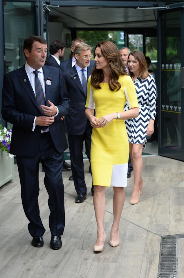 <p>Lemon is a hard shade to pull off but naturally, Kate stunned in this yellow-and-white design by Roksanda Ilincic. Wearing it for a day at Wimbledon, the Duchess fondly called her look the 'banana dress' after William told her she resembled the fruit. <i>[Photo: PA]</i> </p>