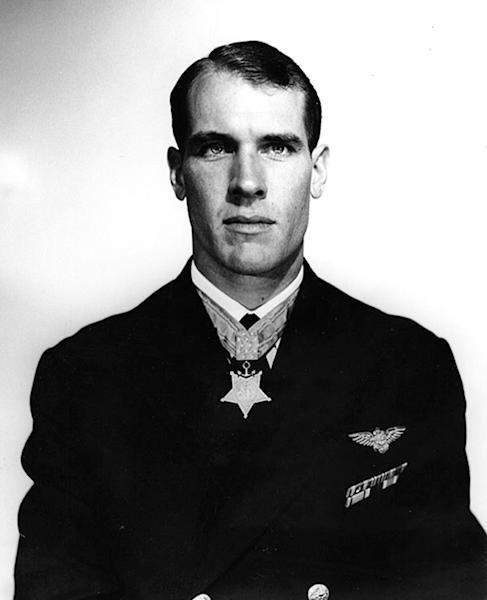 FILE - This April 3, 1950 file photo, provided by the U.S. Navy shows Thomas Hudner who received the Medal of Honor for crash-landing his plane and trying to save Jesse Brown, his wingman, who went down behind enemy lines during the Korean War. Two years after he made history by becoming the Navy's first black pilot, Ensign Jesse Brown lay trapped in his downed fighter plane in subfreezing North Korea, his leg broken and bleeding. His wingman crash-landed to try to save him, and even burned his hands trying to put out the flames. A chopper hovered nearby. Lt. j.g. Hudner could save himself, but not his friend. Hudner heads to Pyongyang on Saturday, July 20, 2013 with hopes of traveling in the coming week to the region known in North Korea as the Jangjin Reservoir, accompanied by soldiers from the Korean People's Army, to the spot where Brown died in December 1950. (AP Photo/U.S. Navy, File)