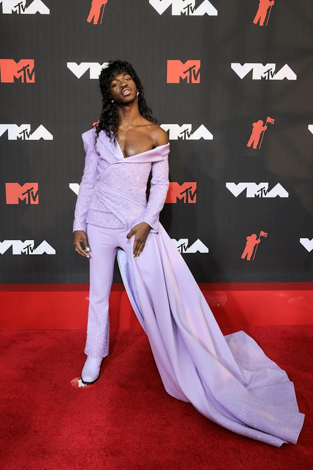 Lil Nas X Hits the MTV VMAs Red Carpet in Glittering Purple Suit With Flowing Train