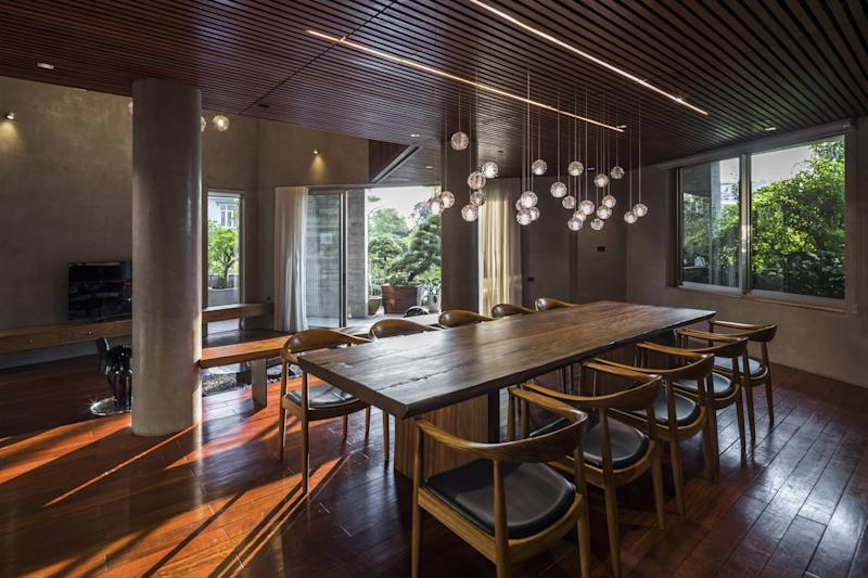 The dining area inside the villa as surprisingly open, with added charm coming from elegant hanging lighting fixtures overhead.
