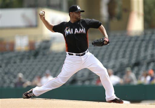 Miami Marlins starting pitcher Ricky Nolasco throws a pitch during the first inning of an exhibition spring training baseball game against the New York Mets, Tuesday, Feb. 26, 2013, in Jupiter, Fla. (AP Photo/Julio Cortez)