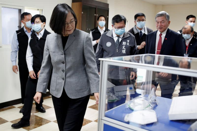 Taiwanese president Tsai Ing-Wen visits a non woven filter fabric factory, where the fabric is used to make surgical face masks, in Taoyuan