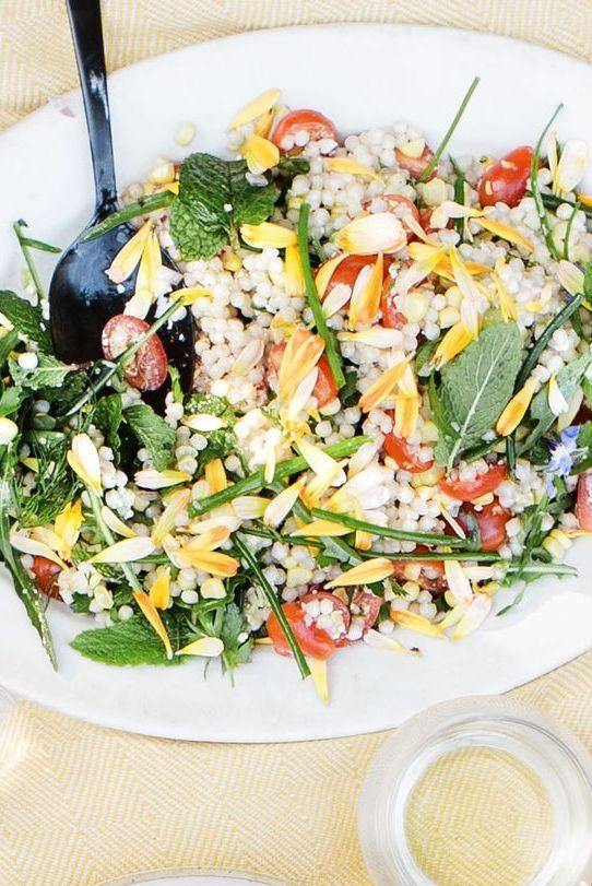 """<p>Showcase your seasonal veggies with this pasta salad that goes perfectly with grilled zucchini and onion. And an added bonus? It only takes 20 minutes! </p><p><em><a href=""""https://www.womansday.com/food-recipes/a32884015/fresh-corn-tomato-herb-and-israeli-couscous-salad-recipe/"""" rel=""""nofollow noopener"""" target=""""_blank"""" data-ylk=""""slk:Get the Fresh Corn, Tomato, Herb, and Israeli Couscous Salad recipe."""" class=""""link rapid-noclick-resp"""">Get the Fresh Corn, Tomato, Herb, and Israeli Couscous Salad recipe.</a></em></p>"""