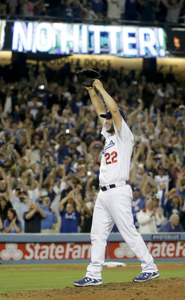 Los Angeles Dodgers starting pitcher Clayton Kershaw celebrates his no hitter against the Colorado Rockies after a baseball game in Los Angeles, Wednesday, June 18, 2014. Kershaw also struck out a career-high 15 batters. (AP Photo/Chris Carlson)