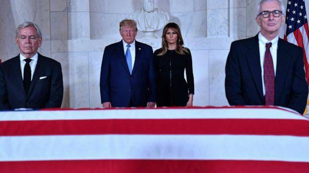 PHOTO: President Donald Trump and first lady Melania Trump pay their respects before the flag-draped casket of late Supreme Court Justice John Paul Stevens in the Great Hall of the Supreme Court in Washington D.C., July 22, 2019. (Nicholas Kamm/AFP/Getty Images)