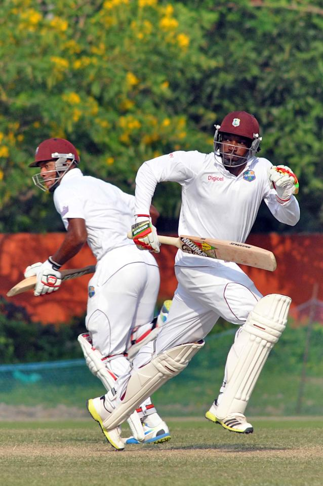 West Indies player Chris Gayle fetches a run during Day 3 of practice match between West Indies and Uttar Pradesh Cricket Association XI at the Jadavpur University Ground in Kolkata on Nov.2, 2013. (Photo: IANS)