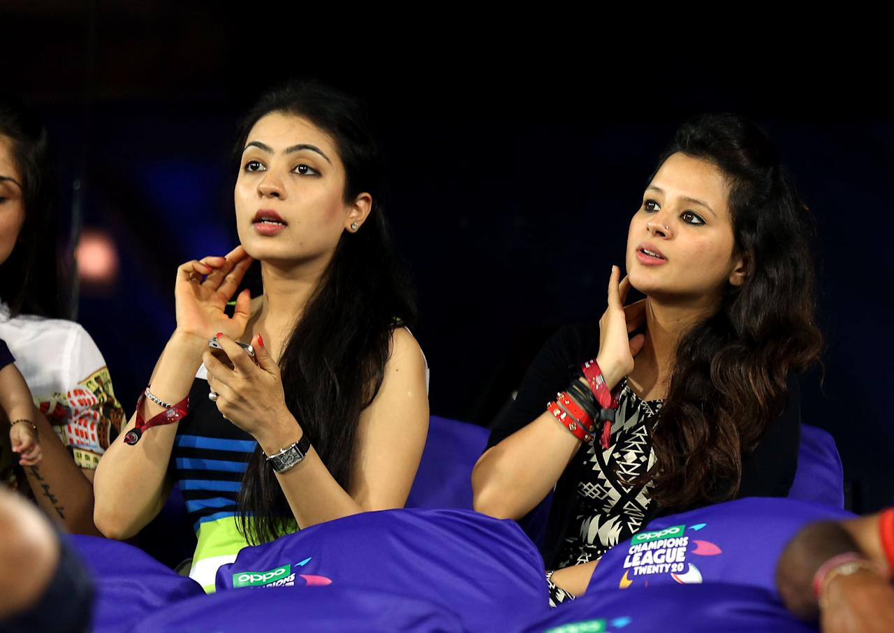 Natasha wife of Gautam Gambhir captain of Kolkata Knight Riders and  Sakshi wife  of M S Dohni captain of  Chennai Super Kings during match 1 of the Oppo Champions League Twenty20 between the Kolkata Knight Riders and the Chennai Superkings held at the Rajiv Gandhi Cricket Stadium, Hyderabad, India on the 17th September 2014  Photo by:  Sandeep Shetty / Sportzpics/ CLT20   Image use is subject to the terms and conditions as laid out by the BCCI/ CLT20.  The terms and conditions can be downloaded here:  https://ec.yimg.com/ec?url=http%3a%2f%2fsportzpics.photoshelter.com%2fgallery%2fCLT20-Image-Terms-and-Conditions-2014%2fG0000IfNJn535VPU%2fC0000QhhKadWcjYs&t=1500922058&sig=BY1pwyNVQmOW6EQ262PdfQ--~C