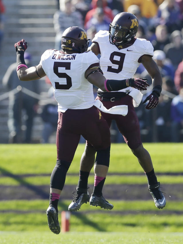 Minnesota linebacker James Manuel (9) celebrates with linebacker Damien Wilson (5) after Manuel sacked Northwestern quarterback Trevor Siemian (13) during the first half of an NCAA college football game in Evanston, Ill., Saturday, Oct. 19, 2013. (AP Photo/Nam Y. Huh)