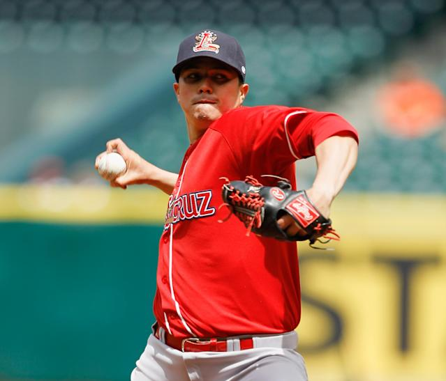 Rojos del Aguila de Veracruz's Manuel Flores pitches in the first inning of a spring exhibition baseball game against the Houston Astros on Sunday, March 30, 2014, in Houston. (AP Photo/Bob Levey)