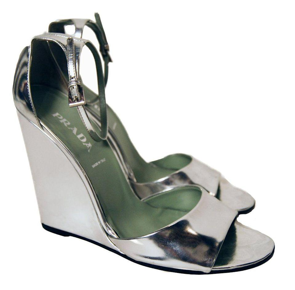 "<p><strong>Prada</strong></p><p>refashioner.com</p><p><strong>$185.00</strong></p><p><a href=""https://refashioner.com/collections/shoes-bags/products/new-prada-mirror-shine-silver-wedge-sandal"" rel=""nofollow noopener"" target=""_blank"" data-ylk=""slk:Shop Now"" class=""link rapid-noclick-resp"">Shop Now</a></p><p>Refashioner is super cool. Not only are the pieces <em>really </em>vintage, but they provide the story behind each piece so you know where your clothes are coming from. They have gently-used Miu Miu, Fendi, and more, so the prices are a little higher, but still a huge steal for these brands.</p>"