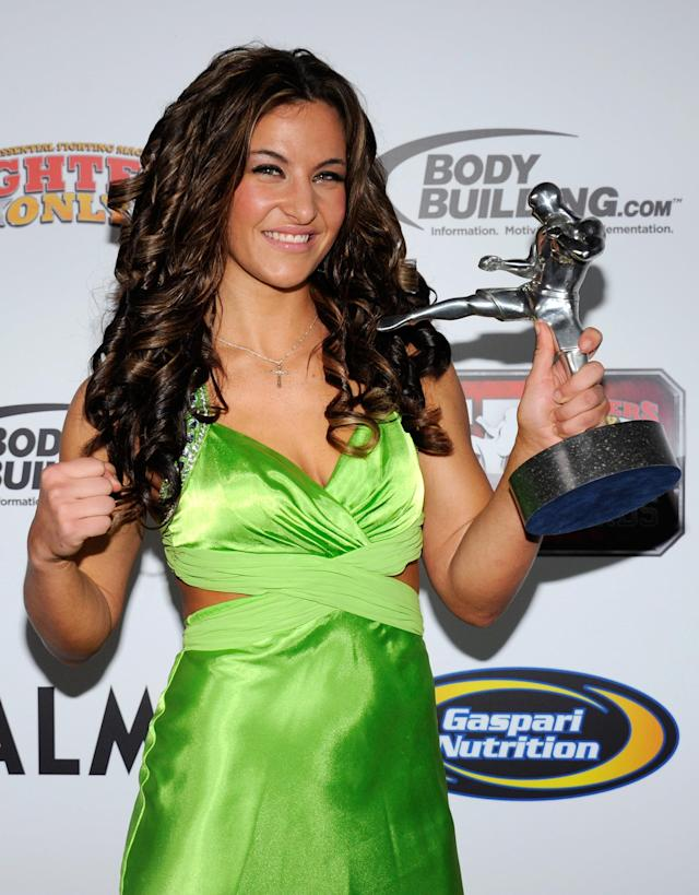 LAS VEGAS, NV - NOVEMBER 30: Mixed martial artist Miesha Tate holds the Female Fighter of the Year award at the Fighters Only World Mixed Martial Arts Awards 2011 at The Pearl concert theater at the Palms Casino Resort November 30, 2011 in Las Vegas, Nevada. (Photo by Ethan Miller/Getty Images)