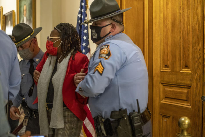 Rep. Park Cannon (D-Atlanta) is placed in handcuffs by Georgia State Troopers after being asked to stop knocking on a door that lead to Gov. Brian Kemp's office while Gov. Kemp was signing SB 202 behind closed doors at the Georgia State Capitol Building in Atlanta, Thursday, March 25, 2021. (Alyssa Pointer/Atlanta Journal-Constitution via AP)