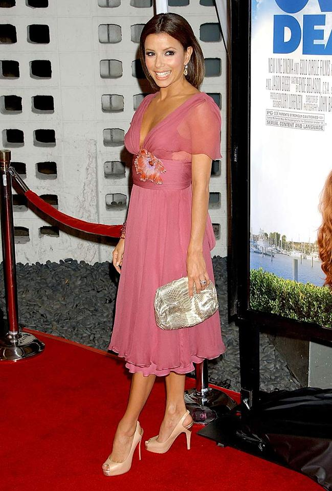 "Eva Longoria struts her stuff in a cute cocktail dress and steep stilettos upon arriving at the ""Over Her Dead Body"" movie premiere at the ArcLight cinema in Hollywood. Gregg DeGuire/<a href=""http://www.wireimage.com"" target=""new"">WireImage.com</a> - January 29, 2008"