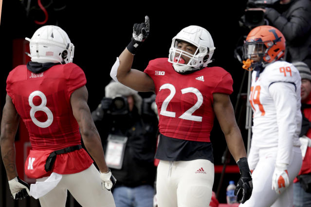 Nebraska running back Devine Ozigbo (22) celebrates his touchdown with wide receiver Stanley Morgan Jr. (8) as Illinois defensive lineman OwenCarney Jr. (99) looks on, during the first half of an NCAA college football game in Lincoln, Neb., Saturday, Nov. 10, 2018. (AP Photo/Nati Harnik)