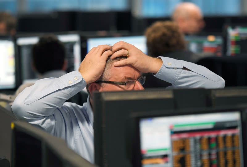 FILE PHOTO: Traders at BGC Partners look at screens after Donald Trump won the U.S. Presidential election, in London