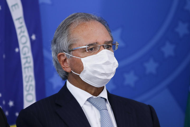Brazil's Economy Minister Paulo Guedes wears a face mask as attends a press conference related to the new coronavirus, COVID-19, at the Planalto Palace, in Brasilia, Brazil on March 18, 2020. (Photo by Sergio LIMA / AFP) (Photo by SERGIO LIMA/AFP via Getty Images)