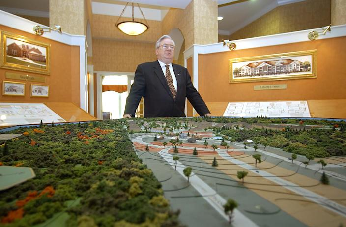 Rev. Jerry Falwell Sr. stands in front of a scale model of Liberty Village, a retirement center he planned outside Lynchburg, on May 30, 2002.