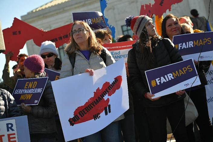 Protestors rallied outside as the US Supreme Court heard a case about gerrymandering (AFP Photo/MANDEL NGAN)