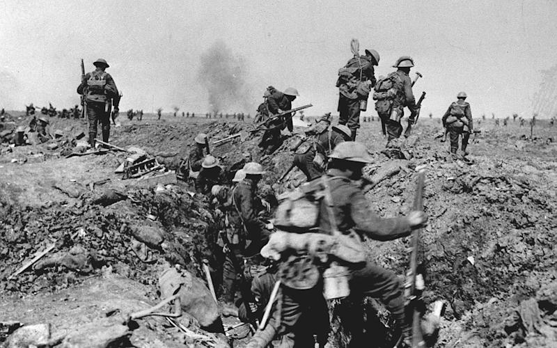 British troops negotiate a trench as they go forward in support of an attack on the village of Morval during the Battle of the Somme - PA