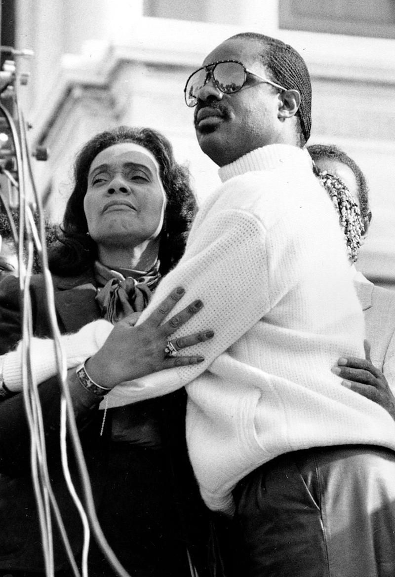 Coretta Scott King, widow of the Rev. Martin Luther King Jr., embraces singer Stevie Wonder during a celebration on the steps of the U.S. Capitol Building in Washington, D.C., Nov. 3, 1983, after President Ronald Reagan signed a bill making the civil rights leader's birthday, Jan. 15, a national holiday.