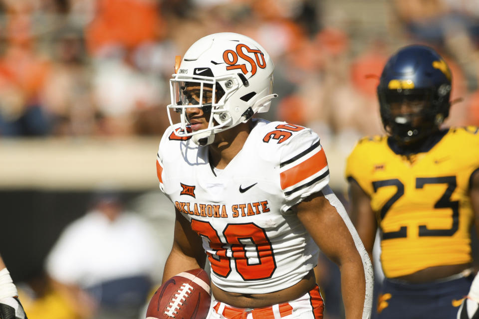 Oklahoma State running back Chuba Hubbard (30) walks the field during an NCAA college football game Saturday, Sept. 26, 2020, in Stillwater, Okla. (AP Photo/Brody Schmidt)