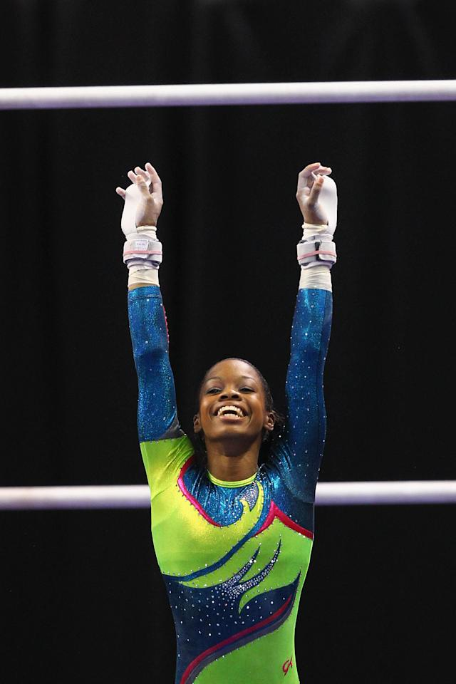 ST. LOUIS, MO - JUNE 10: Gabrielle Douglas sticks her landing on the uneven bars during the Senior Women's competition on day four of the Visa Championships at Chaifetz Arena on June 10, 2012 in St. Louis, Missouri. (Photo by Dilip Vishwanat/Getty Images)