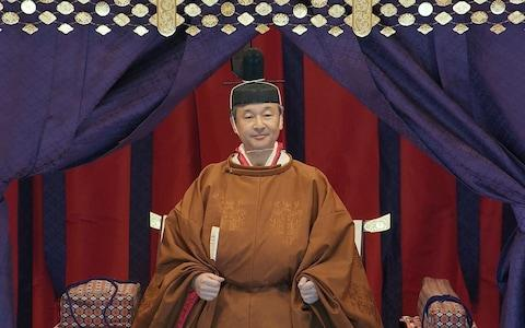 """Japan's Emperor Naruhito stands in the Imperial Throne """"Takamikura"""" - Credit: Pool/Pool"""