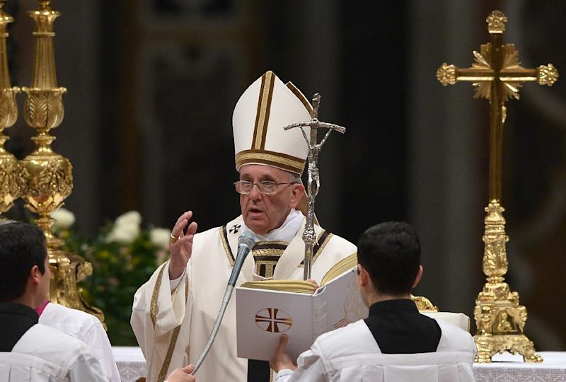 Pope Francis blesses the crowd at the end of the Easter Vigil at St Peter's basilica on April 4, 2015 at the Vatican