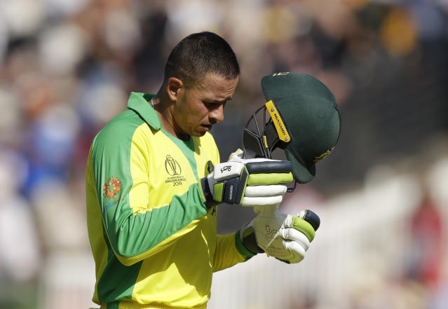 Australia's Usman Khawaja walks off the pitch after being clean bowled by New Zealand's Trent Boult during the Cricket World Cup match between New Zealand and Australia at Lord's cricket ground in London, Saturday, June 29, 2019. (AP Photo/Matt Dunham)