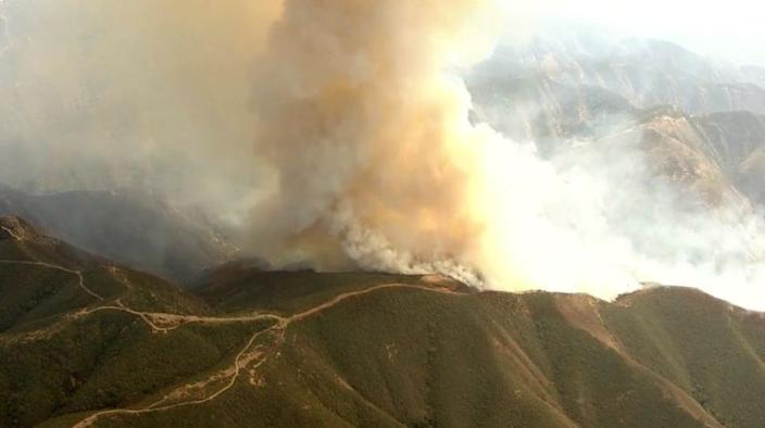 Fast-moving Silverado fire burns in hills of Cleveland National Forest.