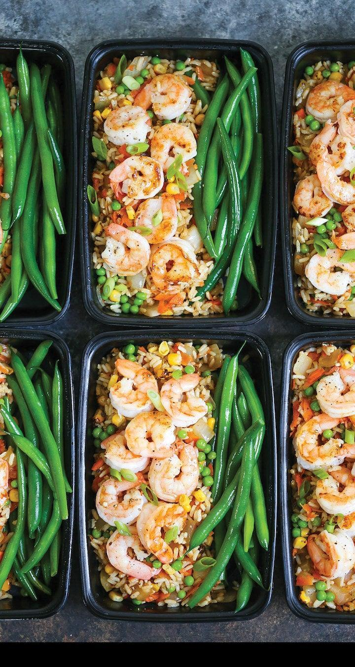 Shrimp fired rice bowls with vegetables.