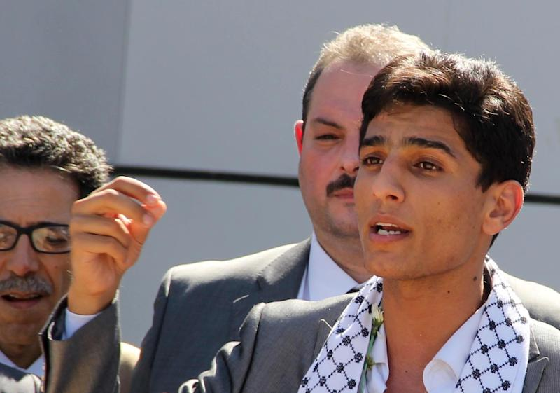 Arab Idol winner Palestinian Mohammed Assaf speaks upon arrival at the Rafah crossing point on the border between Egypt and southern Gaza Strip, Tuesday, June 25, 2013. Huge crowds of Gazans gave a gleeful welcome Tuesday to the first Palestinian winner of the Arab Idol talent contest, thronging the territory's border crossing with Egypt and the singer's home in hopes of embracing him, but internal politics surfaced quickly. Assaf's victory in the popular contest Saturday sparked huge celebrations in the West Bank and Gaza, giving Palestinians a sense of pride. (AP Photo/Khaled Omar, Pool)