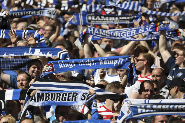 Hamburg fans support their team during the German Bundesliga soccer match between Hamburger SV and SC Freiburg, in Hamburg, Germany, Saturday, April 21, 2018. (Christian Charisius/dpa via AP)
