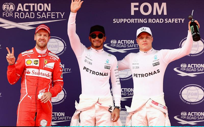 Top three qualifiers Lewis Hamilton of Great Britain and Mercedes GP, Sebastian Vettel of Germany and Ferrari, and Valtteri Bottas of Finland - Credit: Getty Images