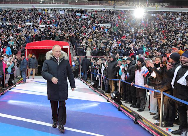 <p>Russian President Vladimir Putin arrives to take part in a rally to support his bid in the upcoming presidential election, at Luzhniki Stadium in Moscow, Russia, March 3, 2018. (Photo: Sputnik/Mikhail Klimentyev/Kremlin via Reuters) </p>