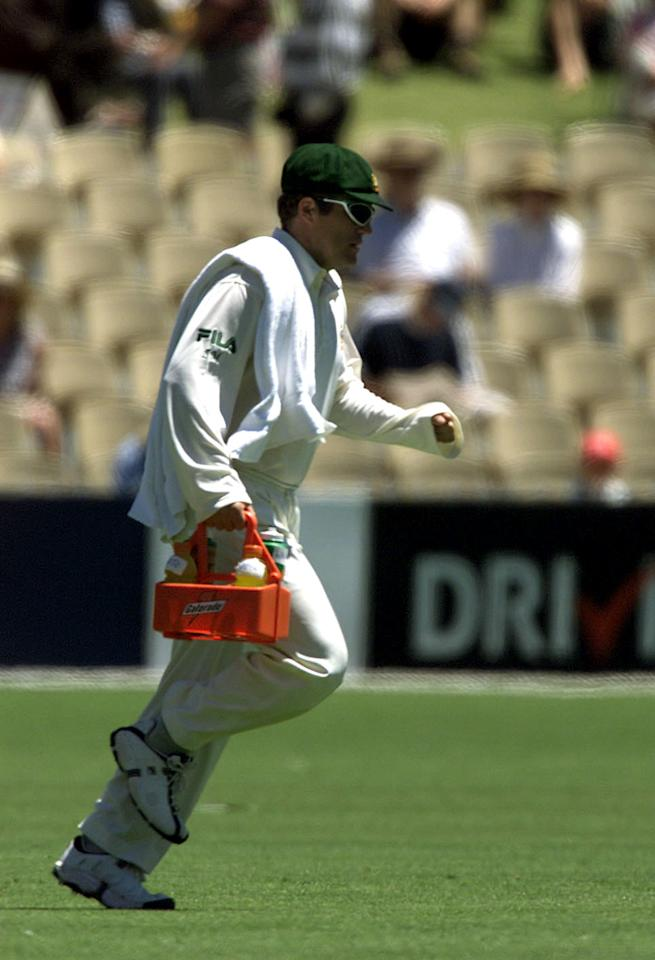 15 Dec 2001:  Stuart MacGill of Australia brings the drinks onto the ground during the second day of play in the First Test between Australia and South Africa being played at the Adelaide Oval, Adelaide, Australia.  DIGITAL IMAGE. Mandatory Credit: NickWilson/ALLSPORT