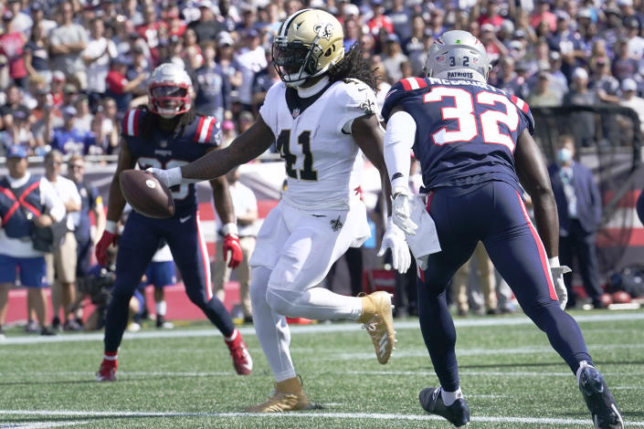 New Orleans Saints running back Alvin Kamara (41) steps into the end zone for a touchdown ahead of New England Patriots free safety Devin McCourty (32) during the first half of an NFL football game, Sunday, Sept. 26, 2021, in Foxborough, Mass. (AP Photo/Steven Senne)